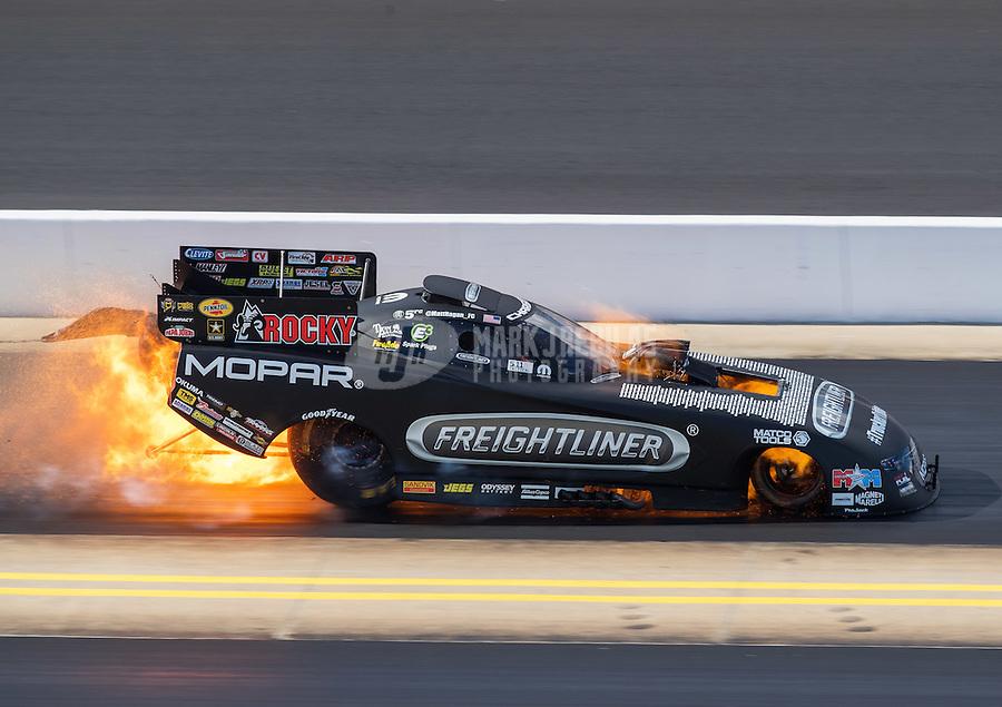 Sep 17, 2016; Concord, NC, USA; NHRA funny car driver Matt Hagan suffers an engine fire during qualifying for the Carolina Nationals at zMax Dragway. Mandatory Credit: Mark J. Rebilas-USA TODAY Sports