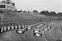 HAMPTON, GA - APRIL 22: Johnny Rutherford (#4 McLaren M24B/Cosworth TC) and Gordon Johncock (#20 Penske PC6/Cosworth TC) lead the field on a pace lap before the second race of the Gould Twin Dixie 125 event on April 22, 1979, at Atlanta International Raceway near Hampton, Georgia.