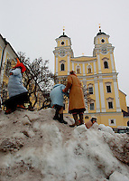 "Children play in the snow during Mozart Week outside the Catholic church where ""The Sound of Music"" was filmed near Salzburg, Austria February 28 2006.  (Photo by Alan Greth)"