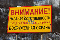 "Altai Region, Siberia, Russia, 25/02/2011..Sign at the entrance to the area of the first casino at the proposed Siberian Coin casino project in the Altai mountains. The sign reads: ""Warning! Private territory - no entry without invitation. Armed guards"", and appears to have been damaged by bullets."