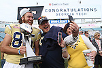 Punter Ryan Rodwell #85 of the Georgia Tech Yellow Jackets poses with fans after they defeated the Kentucky Wildcats in the TaxSlayer Bowl at EverBank Field on Saturday, December 31, 2016 in Jacksonville, Florida. Photo by Michael Reaves | Staff.