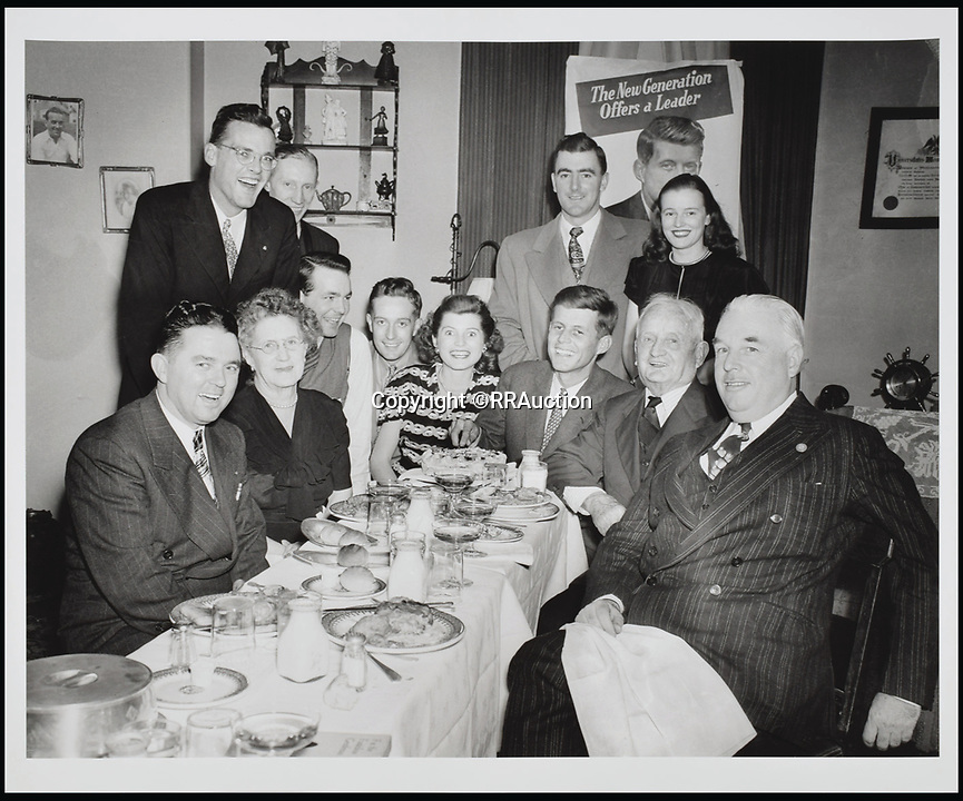 BNPS.co.uk (01202 558833)<br /> Pic: RRAuction/BNPS<br /> <br /> Kennedy's 1946 primary campaign victory dinner at the Bellevue Hotel in Boston.<br /> <br /> Incredibly-rare photos highlighting the first foray into politics for John F. Kennedy that would eventually cost him his life have come to light.<br /> <br /> The 100 black and white snaps show a youthful-looking JFK from 1946, when he was campaigning to become a US congressman for the first time.<br /> <br /> The tragic future president is seen during an oration lesson where he was given help by an expert with public speaking and posture.<br /> <br /> The 29-year-old is also depicted mingling with the public at an annual parade and as well as celebrating his first political victory - a congressional primary vote - in June 1946.<br /> <br /> The images are being sold by US-based RR Auction.