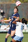 6 November 2005: Virginia's Kelly Quinn (left) heads the ball as North Carolina's Ariel Harris looks on. The University of North Carolina defeated the University of Virginia 4-1 at SAS Stadium in Cary, North Carolina in theifinals of the 2005 ACC Women's Soccer Championship.