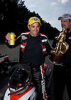 May 19, 2014; Commerce, GA, USA; NHRA pro stock motorcycle rider Eddie Krawiec celebrates after winning the Southern Nationals at Atlanta Dragway. Mandatory Credit: Mark J. Rebilas-USA TODAY Sports