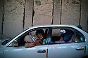 A family sit and wait in a car in a traffic jam inside the Salang tunnel in the Parwan province. Even though in very bad shape, the road through the Salang Pass is the only major route over the Hindu Kush mountains linking southern Afghanistan to the north and Central Asia that remains open throughout the year. Afghanistan, 2012