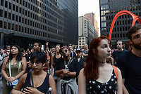 Demonstrators gather in Federal Plaza to support a Citizens Police Accountability Council to provide civilian oversight of the Chicago Police Department in Chicago, Illinois on July 11, 2016.  The demonstration attracted a larger crowd on the heels of last week's racially charged police shootings captured on video of Alton Sterling in Baton Rouge, Louisiana and Philando Castile in the St. Paul suburb of Falcon Heights, Minnesota which was followed by a mass shooting of five police officers by Afghan War veteran Micah Johnson who supported radical and violent black nationalist ideology.