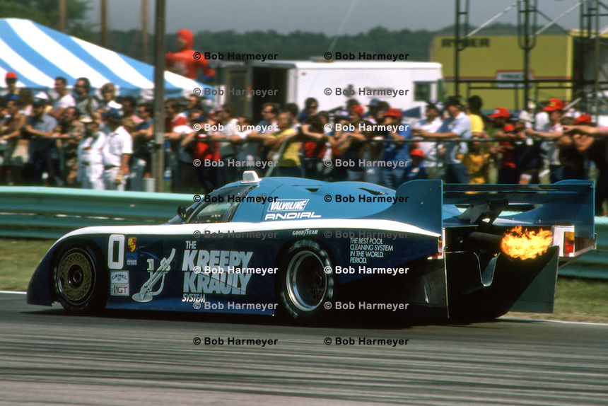ELKHART LAKE, WI - AUGUST 24: The March 84G 3/Porsche of Ian Scheckter of South Africa and Sarel van der Merwe of South Africa is driven toward Turn 5 during the Budweiser 500 IMSA GT race at the Road America track near Elkhart Lake, Wisconsin, on August 26, 1984.