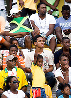 A young Jamaican fan waves the national colors during the group stage of the CONCACAF Men's Under 17 Championship at Catherine Hall Stadium in Montego Bay, Jamaica. Jamaica defeated Guatemala, 1-0.