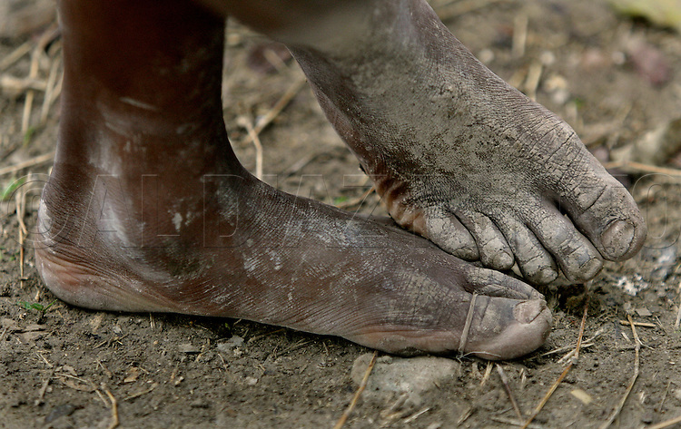 Many children are seen in camp without shoes at Haiti's only golf course now home to tens of thousands of earthquake survivors at the Petion-Ville Club golf course on March 5. 2010.....'