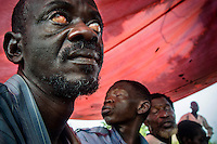 A man with severe eye conditions wait to be examined by ophthalmologist Doctor Richard Hardi in the remote village of Pania. <br /> <br /> From his base in Mbuji Mayi Hungarian ophthalmologist Friar Richard Hardi and his team travelled deep into the Congolese rainforest, by 4x4 and canoe, to treat people in isolated communities most of whom have never seen an ophthalmologist. At a small village called Pania they established a temporary field hospital and over the next three days made hundreds of consultations. Although both conditions are preventable, many of the patients they saw had Glaucoma or River Blindness (onchocerciasis) that had permanently damaged their eyesight. However, patients with cataracts, a clouding of the eye's lens, who were suitable for treatment were booked for an operation. For two days the team carried out the ten minute procedure on one patient after another. The surgery involves making a 2.2mm incision into the remove the damaged lens that is then replaced by an artificial one. Doctor Hardi is one of the few people willing to make such a journey but is inspired to do so by his faith and, as he says: 'Here I feel that I can really make a difference in people's lives'. /Felix Features