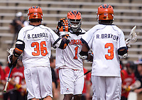 Brian Carroll (36) of Virginia celebrates a goal with teammates Shamel Bratton (1) and Rhamel Bratton (3) during the ACC men's lacrosse tournament finals in College Park, MD.  Virginia defeated Maryland, 10-6.