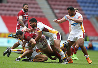 Wigan Warriors' Ben Flower is tackled by Huddersfield Giants' Sam Rapira (left) and Kruise Leeming (right) <br /> Photographer Stephen White/CameraSport<br /> <br /> Betfred Super League Round 5 - Wigan Warriors v Huddersfield Giants - Sunday 19th March 2017 - DW Stadium - Wigan<br /> <br /> World Copyright &copy; 2017 CameraSport. All rights reserved. 43 Linden Ave. Countesthorpe. Leicester. England. LE8 5PG - Tel: +44 (0) 116 277 4147 - admin@camerasport.com - www.camerasport.com