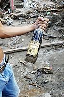 un-opened wine bottle salvaged from the debris left by huricane stan.  Miguel de la Madrid neighbourhood, Tapachula Chiapas