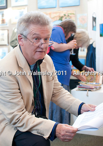 Bob Meecham, Assistant Curriculum Manager for Art at Surrey County Council, at the opening of an exhibition of students' work, Harvey Gallery, Adult Learning Centre, Guildford, Surrey.
