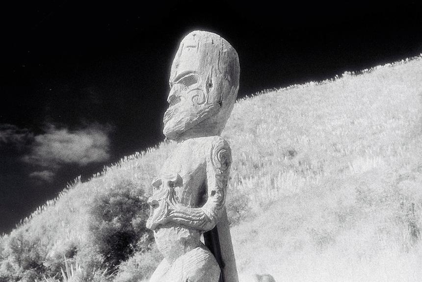 Tohu. Maori carved figure at Ngarunui Beach, Raglan.