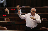 Knesset member Reuven Rivlin from the Likud party during a vote on the so-called governability law. The governance law would raise the electoral threshold from 2 percent to 4 percent. Photo by Oren Nahshon