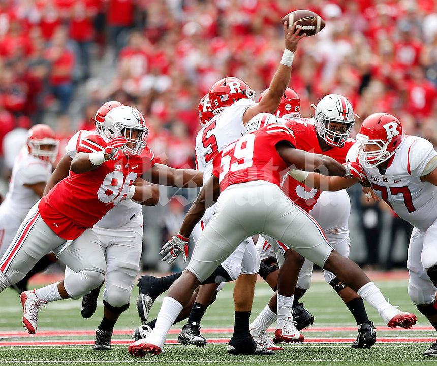 Ohio State Buckeyes defensive lineman Dre'Mont Jones (86), Ohio State Buckeyes defensive lineman Tyquan Lewis (59) and Ohio State Buckeyes linebacker Raekwon McMillan (5) converge on Rutgers Scarlet Knights quarterback Chris Laviano (5) during the first quarter of the NCAA football game between the Ohio State Buckeyes and the Rutgers Scarlet Knights at Ohio Stadium on Saturday, October 1, 2016. (Columbus Dispatch photo by Jonathan Quilter)