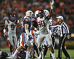 Ole Miss' Gerald Rivers (90) celebrate a fumble recovery at Jordan-Hare Stadium in Auburn, Ala. on Saturday, October 29, 2011. Ole Miss' Kentrell Lockett (40) recovered the ball..