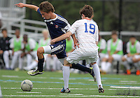 HYATTSVILLE, MD - OCTOBER 26, 2012:  Thomas Madden (19) of DeMatha Catholic High School defends against Nick Notaro (12) of St. Albans during a match at Heurich Field in Hyattsville, MD. on October 26. DeMatha won 2-0.
