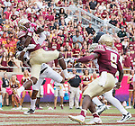 Florida State wide receiver Auden Tate catches a touchdown pass over Wake Forest cornerback Brad Watson in the second half of an NCAA college football game in Tallahassee, Fla., Saturday, Oct. 15, 2016. Florida State defeated Wake Forest 17-6. (AP Photo/Mark Wallheiser)