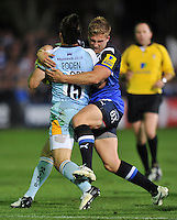 Ben Williams tackles Ben Foden. Aviva Premiership match, between Bath Rugby and Northampton Saints on September 14, 2012 at the Recreation Ground in Bath, England. Photo by: Patrick Khachfe / Onside Images