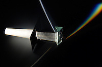WHITE LIGHT IS REFRACTED BY A TRIANGULAR PRISM<br /> Forming a spectrum of its component colors<br /> The light source passes through a slit focusing the light beamed at the prism. The refractive index of the prism substance varies for the different wavelengths of visible light which is thus separated to form a spectrum.