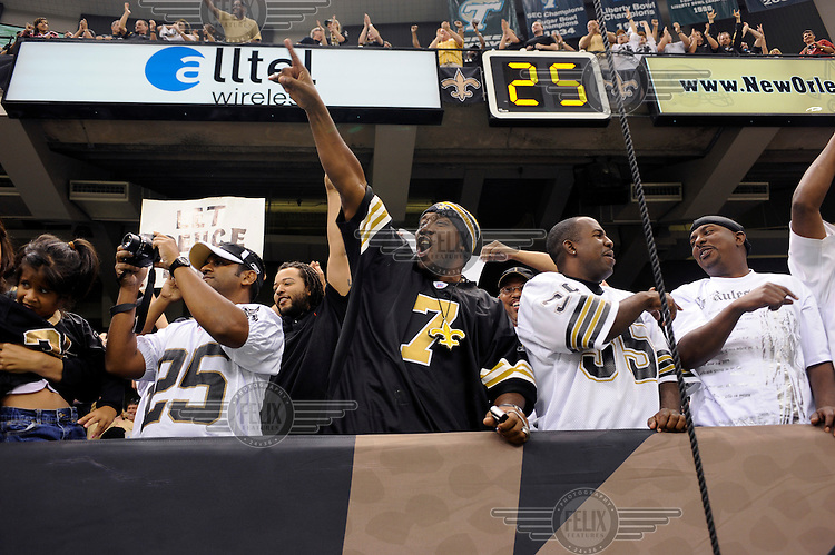New Orleans Saints fans celebrate a touchdown during their American Football match with the San Francisco 49'ers.