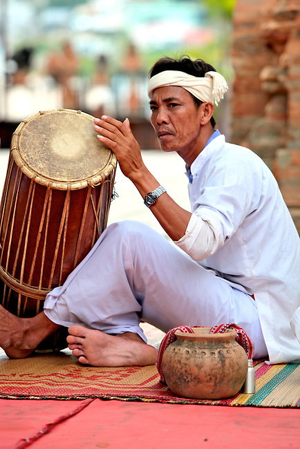 A Cham musician plays a drum at the Po Nagar Cham Towers in Nha Trang, Vietnam. July 14, 2011.