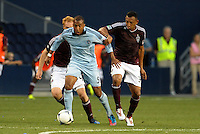 Teal Bunbury (9) Sporting KC forward takes the ball past Colorado's Jeff Larentowicz and Tyrone Marshall..Sporting Kansas City defeated Colorado Rapids 2-0 in Open Cup play at LIVESTRONG Sporting Park, Kansas City, Kansas.