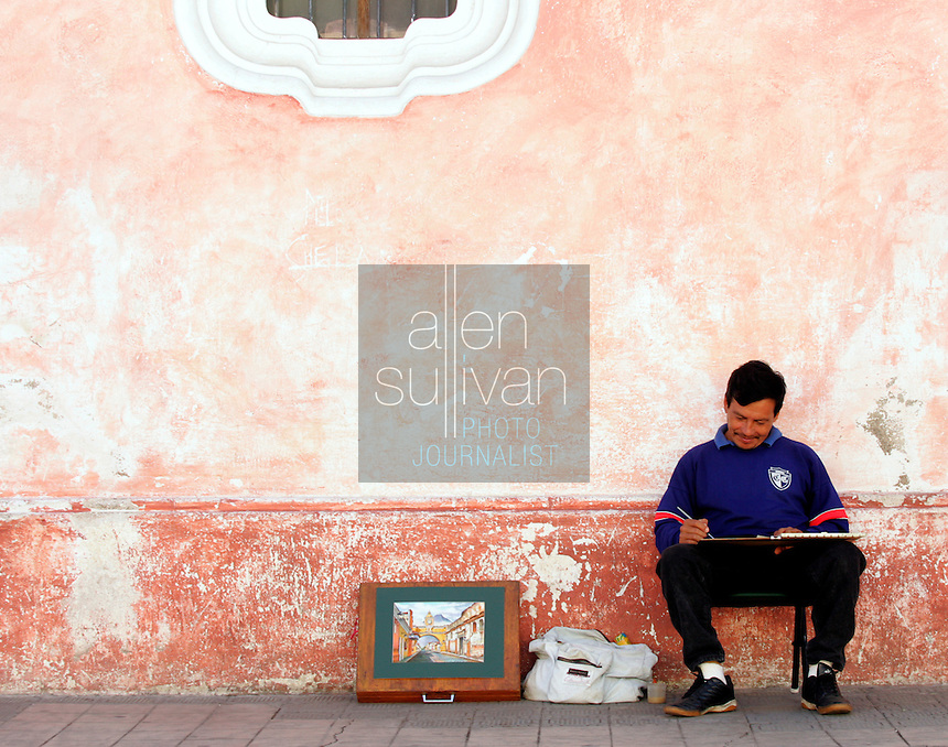 Victor Arias paints street scenes on 5a Avenida Norte. Until 1776, Antigua was Guatemala's third capital city, but was nearly destroyed by earthquakes. Today, Antigua is Guatemala's foremost tourist center and a UNESCO World Heritage site.<br />