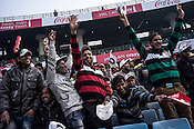 Pakistani and Indian supporters at the cricket ground during the final match at the Firozshah Kotla cricket stadium in New Delhi, India.
