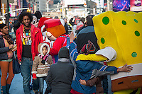 """Costumed characters swarm Times Square in New York on Friday, December 28, 2012. The """"actors"""" pose for photographs with tourists asking for tips as renumeration. Recently a number of them have been embroiled in controversy for groping women and anti-semitic ranting. Otherwise they just aggressively come up to people soliciting photos. (© Richard B. Levine)"""