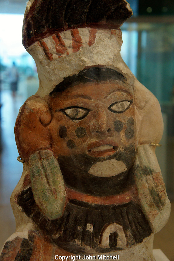 Polychrome face from Oxtankah, Museo Maya de Cancun or Cancun Mayan Mayan Museum that opened in November 2012, Cancun, Mexico      .