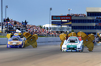 May 31, 2009; Topeka, KS, USA: NHRA funny car driver Ron Capps (left) slows down after defeating Ashley Force Hood in the final round of the Summer Nationals at Heartland Park Topeka. Mandatory Credit: Mark J. Rebilas-