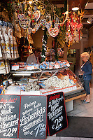 German sausages and souvenirs on sale in food market in Munich, Bavaria, Germany
