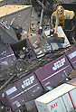 March 13, 2011: People removing packages from toppled freight train in Yamamotocho, Miyagi Prefecture, 5PM on March 13, 2011. Photographed by Junichi  Sasaki from a company helicopter.(Photo by Mainichi Newspaper / Aflo)