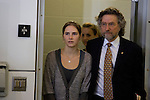Amanda Knox, left, follows her attorney Michael Nifong as they attend a news conference held at the Seattle-Tacoma International Airport near Seattle, Washington on October 4, 2011. After spending four years in an Italian prison Knox arrived in the United States after departing Rome's Leonardo da Vinci airport. Knox's life turned around dramatically Monday when an Italian appeals court threw out her conviction in the sexual assault and fatal stabbing of her British roommate. ©2011. Jim Bryant Photo. All Rights Reserved.