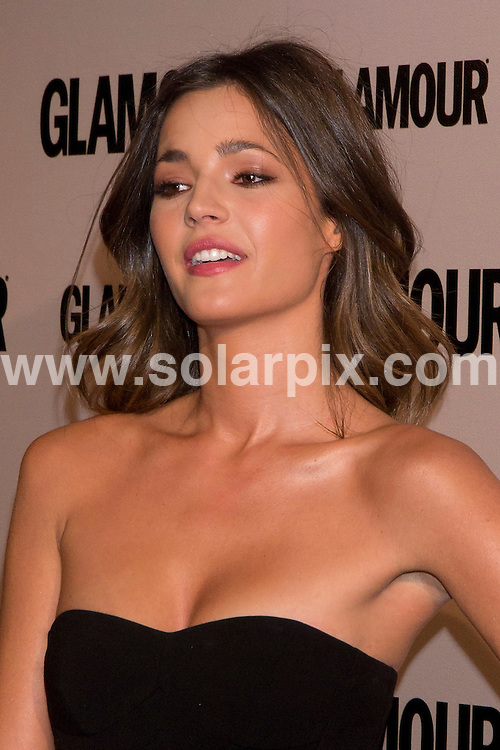 **ALL ROUND PICTURES FROM SOLARPIX.COM**                                             **WORLDWIDE SYNDICATION RIGHTS EXCEPT SPAIN - NO SYNDICATION IN SPAIN**                                                                                  Glamour Magazine delivers the Glamour Beauty Awards at Pacha Nightclub in Madrid, Spain.                                                                          This pic:   Spanish fashion model, Malena Costa, who used to be the girtlfriend of Barcelona's Carles Puyol, shows off her knuckle duster handbag.                                                                                          JOB REF:    14566    DMS       DATE:    14/03/2012                                                        **MUST CREDIT SOLARPIX.COM OR DOUBLE FEE WILL BE CHARGED**                                                                      **MUST AGREE FEE BEFORE ONLINE USAGE**                               **CALL US ON: +34 952 811 768 or LOW RATE FROM UK 0844 617 7637**