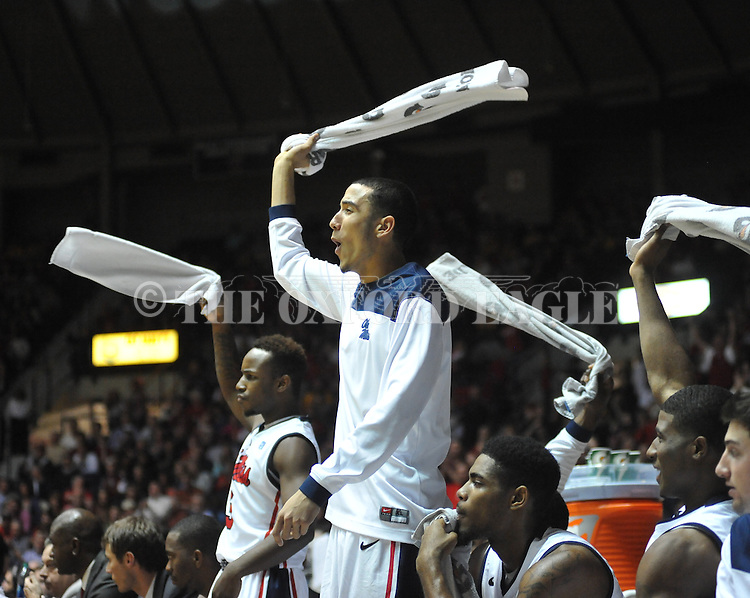 Ole Miss' Anthony Perez (13) and Ole Miss' Derrick Millinghaus (3) cheer vs. Missouri at the C.M. &quot;Tad&quot; Smith Coliseum on Saturday, January 12, 2013. Ole Miss defeated #10 ranked Missouri 64-49.