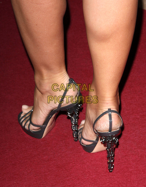 ELIZABETH HURLEY's feet .Attending the GQ Men Of The Year Awards 2009