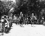 Waterbury militia company parading by the Green on West Main Street, ca, 1900.