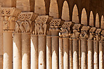 Column capitals carved into birds, people, and flowers in front of the Church of San Martin, an 11th century church; located on Calle Juan Bravo