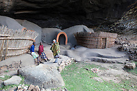 """May 2010, Lesotho. Farming activity as the maize harvest is brought in before the winter. Ha Kome caves, where people from the same family have lived uninterrupted since the """"difaqane"""" - a forced migration that took place as a consequence of a  series of wars that took place between 1795 and 1870"""