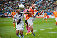 CARSON, CA-DECEMBER 1, 2012 -  Corey Ashe keeps the ball from LA's Sean Franklin during the 2012 MLS Cup Championship at the Home Depot Center in Carson, CA.  The LA Galaxy defeated the visiting Houston Dynamo 2-1 to repeat as Cup champions.