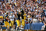 Michigan Wolverines celebrate after scoring a touchdown against the UCLA Bruins at Michigan Stadium in Ann Arbor, Michigan on 9/25/82. Photo by John D. Hanlon, 25-year photographer for Sports Illustrated.