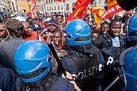 Roma, 23 Marzo 2015<br /> Manifestazione di migranti richiedenti asilo che chiedono un  permesso di soggiorno umanitario per tutti, un&rsquo;accoglienza dignitosa  e la possibilit&agrave; di un lavoro per tutti e per dire &laquo;no allo sfruttamento e al business dell&rsquo;accoglienza&raquo;. La manifestazione &egrave; organizzata dal sindacato  Usb.  Momenti di tensione tra manifestanti e polizia davanti alla prefettura.<br /> Rome, March 23, 2015<br /> Demonstration by asylum-seeking immigrants who they ask  a humanitarian residence permit for all , decent reception and the possibility of a job for everyone and say &quot;no to exploitation and to the business of hospitality.&quot; The protest  is organized by the union Usb. Moments of tension between demonstrators and police outside the prefecture.