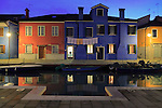 A classic view of Burano's coloured houses reflected in a canal. Taken about 30 minutes after sunset.