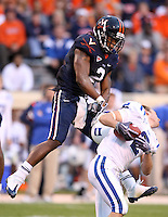 Virginia quarterback Brendan Lane (2) rips the helmet off of Duke wide receiver Conner Vernon (2) during an ACC football game Saturday in Charlottesville, VA. Duke won 28-17. Photo/Andrew Shurtleff