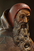 Statue of St Anthony the hermit, patron saint of the Hospices and protector from epidemics and ergotism, in painted limestone, late 15th century, in Les Hospices de Beaune, or Hotel-Dieu de Beaune, a charitable almshouse and hospital for the poor, built 1443-57 by Flemish architect Jacques Wiscrer, and founded by Nicolas Rolin, chancellor of Burgundy, and his wife Guigone de Salins, in Beaune, Cote d'Or, Burgundy, France. The hospital was run by the nuns of the order of Les Soeurs Hospitalieres de Beaune, and remained a hospital until the 1970s. The building now houses the Musee de l'Histoire de la Medecine, or Museum of the History of Medicine, and is listed as a historic monument. Picture by Manuel Cohen