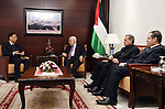 Palestinian President Mahmoud Abbas meets with Chinese ambassador, in the West Bank city of Ramallah, on December 19, 2016. Photo by Thaer Ganaim